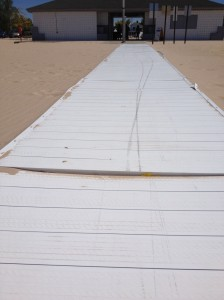 The boardwalk, which is constructed of flimsy panels that are molded to look like boards. The pictures show where the panels do not line up with one another, creating access issues and safety hazards. The metal border on the panels is coming off in several places along the edge of the boardwalk