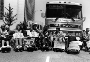 ADAPT Protesters Surround a GreyHound Bus